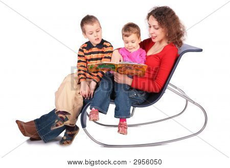 Mother Reads Book With Children Sit On Chair