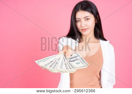 Successful Beautiful Asian Business Young Woman Holding Money Us Dollar Bills In Hand On Pink Backgr