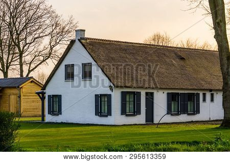 Classical Dutch Farmer House With A Thatched Roof, Architecture At The Countryside Of The Netherland