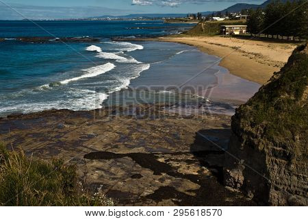 Beach At Clifton 2, Illawarra, Nsw Near Wollongong With Rocks In Foreground.
