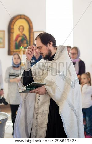 Orenburg, Russian Federation-2 Aprel 2019. Young Orthodox Priest To Be Baptized During The Liturgy