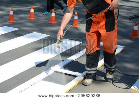 Technical Road Man Worker Painting And Remarking Pedestrian Crossing Lines On Asphalt Surface Using
