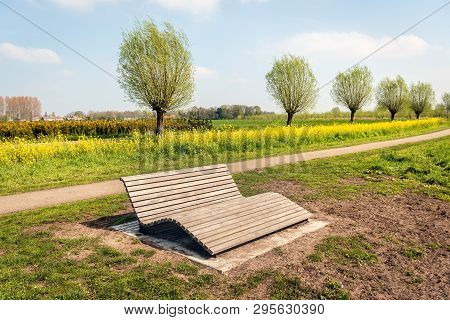 Comfortable Wooden Slat Bench In A Dutch Park Near The Village Of Wagenberg, North Brabant. It Is Sp