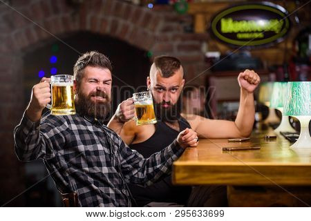Alcohol Drinks. Friends Relaxing In Pub With Beer. Refreshing Beer Concept. Men Drinking Beer Togeth