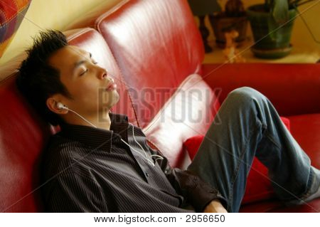 Asian Boy Relaxing With Music