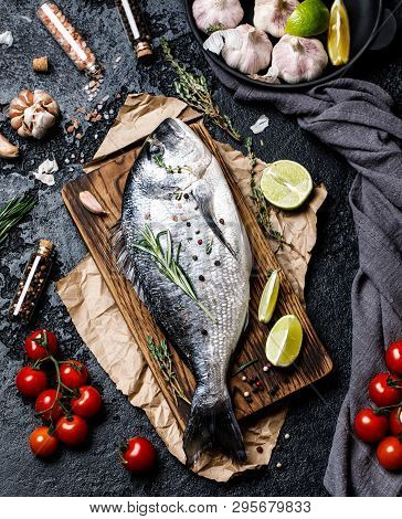Fresh Fish Dorado. Raw Dorado Fish And Ingredient For Cooking. Fresh Fish Gilt-head Bream Dorade Wit