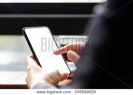 Close Up Woman Hand Using A Smart Phone At Cafe Coffee Shop, Blank Screen Mobile Phone For Graphic D