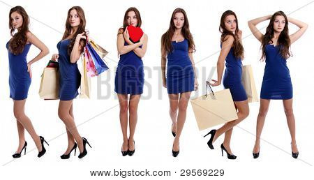 Comprimento total de uma moça bonita no vestido de pé contra o fundo branco isolado