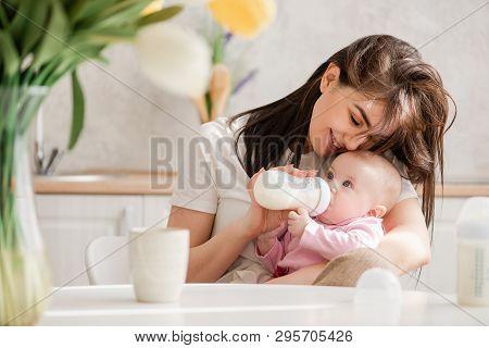 Feeding Newborn Girl With Formula In A Bottle.