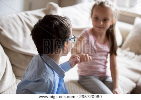 Brother And Sister Squeeze Little Fingers As Sign Of Reconciliation