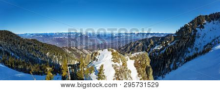 Panoramic View Over Olt Valley And Fagaras, The Highest Mountain Range In Romania During Winter From