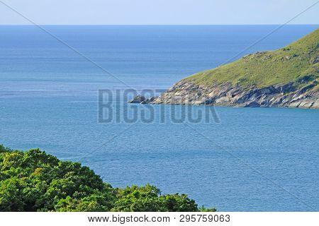 Sea Watercourse Or Water Channel Between Two Rocky Green Islands