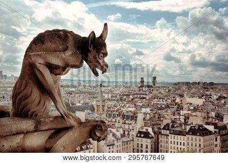 Notre Dame Demon Gargoyle And View Of Paris