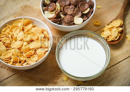 Breakfast Cornflakes And Various Cereals In Bowl And Milk Cup On Wooden Background For Cereal Health