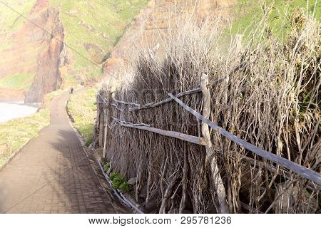 An Old Hand-made Dry Branch Fence Off The Coast Of Madeira Island. Side View, Horizontal, Close-up,