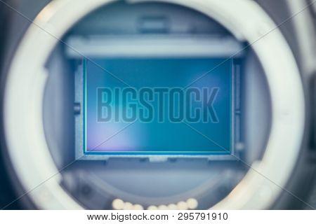 Professional reflex camera on a table, camera sensor poster
