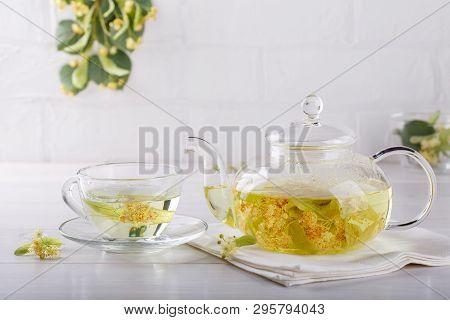 Linden Tea In A Transparent Tea Pot.  Glass Tea Pot With Herbal Lime Tree Tea On White Background. M