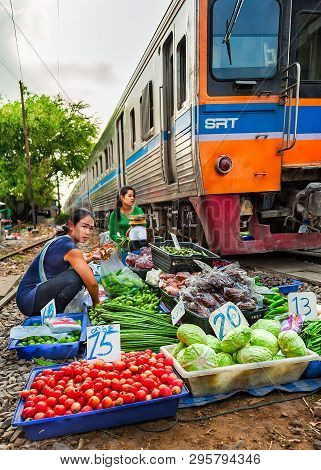 Samutsakorn Province, Thailand - March 14, 2019: Open Air Market Along Train Tracks. Daily Life Of A