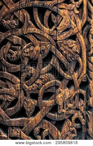 Ornaments Of Ancient Vikings On A Wooden Surface. External Wooden Wall Carved Decoration Of Medieval