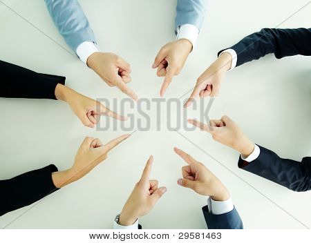 Top view of businesspeople pointing at each other