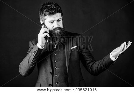 Discussing News. Passionate About Work. Businessman In Suit Discussing. Online And Agile. Brutal Cau