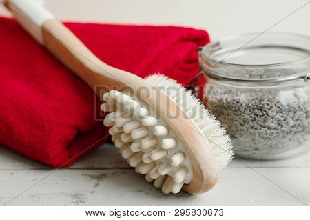 Multipurpose Brush For Body Massage, Homemade Scrub And Red Cotton Towel On Wooden Background. Cellu