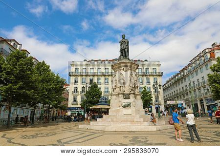 Lisbon, Portugal - June 25, 2018: View On The Statue Of Luiz Camoes On The Square In Lisbon City, Po