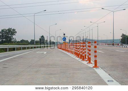 The Orange Traffic Pole Or Flexible Traffic Bollard On Asphalt Road For Crossroad