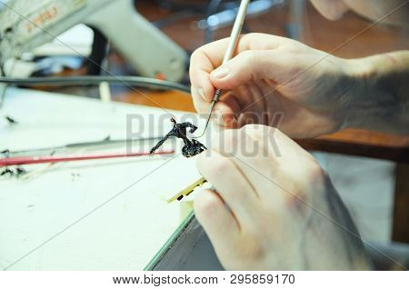 sculptor at work. young man sculpting handmade toy bee from plastic glue, house decoration craftsmanship hobby, decor creation process poster