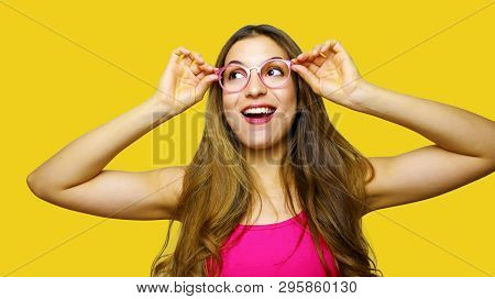 Funny Portrait Of Excited Girl Wearing Glasses Eyewear. Closeup Portrait Of Young Woman Making Funny