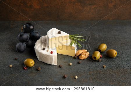 Cheese Camembert Or Brie With Olives And Grapes