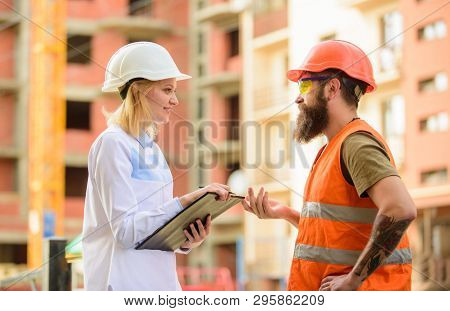 Construction Project Inspecting. Safety Inspector Concept. Woman Inspector And Bearded Brutal Builde