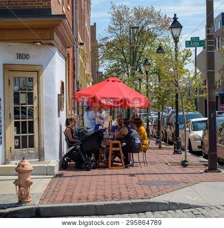 Fells Point, Baltimore, Md, Usa -- April 13, 2019. Diners Enjoy Breakfast Outside In Fells Point, Ba
