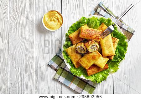 Savory Crepe Rolls With Ground Chicken Meat And Mushrooms Filling Served On A Bad Of Fresh Lettuce L