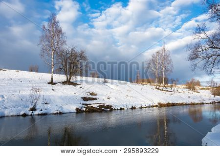Beautiful Spring Landscape With A Small Quiet River On A Cloudy Day.