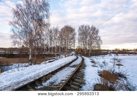 Beautiful March Landscape With Birches And A Railroad Leaving Into The Distance.