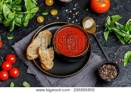 Traditional Spanish Cold Tomato Soup Gazpacho In A Bowl On Stone Background. Traditional Spanish Foo
