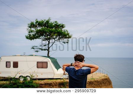 Handsome, Young Guy Posing On A Wild Seashore