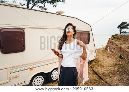 Beautiful, Young Girl Posing On A Wild Beach Sailor At The Van