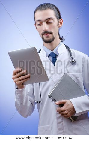 Doctor working on the tablet