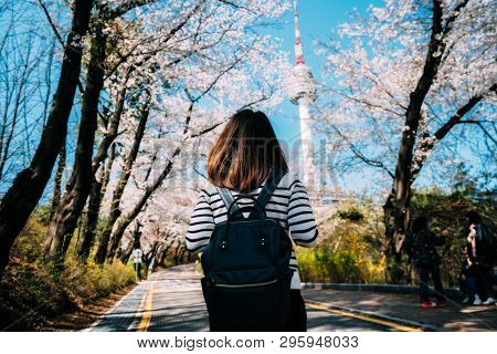 Young Woman Traveler Backpacker Traveling Into N Seoul Tower At Namsan Mountain In Seoul City, South