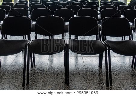 Empty Chairs In The Foyer Of A Hall