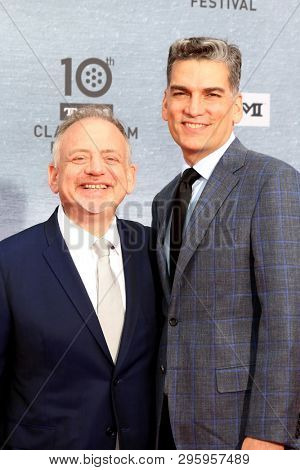 LOS ANGELES - APR 11:  Marc Shaiman, Lieutenant Commander Louis Mirabal at the 2019 TCM Classic Film Festival Gala at the TCL Chinese Theater IMAX on April 11, 2019 in Los Angeles, CA