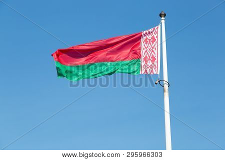 The Flag Of Belarus Close Up With A Blue Sky.