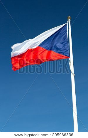 Flag Of The Czech Republic Close Up With A Clear Blue Sky.