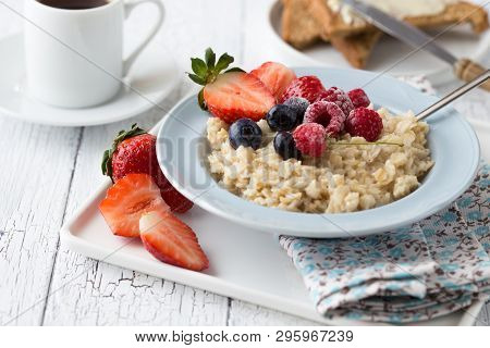 Breakfast Oatmeal Porridge With Fruits Berries And Coffee Cup. Oatmeal With Strawberries And Berry.