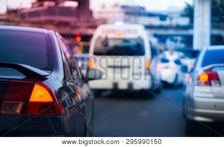 Traffic Jam And Ambulance Car Concept - Car Brake Light On Bangkok Traffic Jam Hour With Blurred Amb
