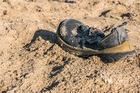 Old,  Worn Out,  Trash  Shoe Washed Up On The Beach. Red Sea, Egipt Africa