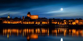 Old Town Reflected In River At Sunset. Torun