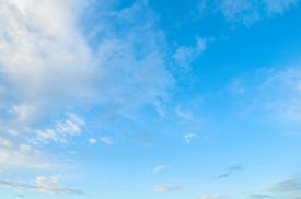 Blue sky background with white dramatic colorful clouds and sunlight, vast sky background. Natural sky landscape view, sky background with white clouds in the blue sky